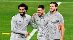 Liverpool's form man Mohamed Salah (L) laughs with Alberto Moreno (C) and Adam Lallana (C), who could make his first appearance of the season tonight. Photo: Cristina Quicler/AFP
