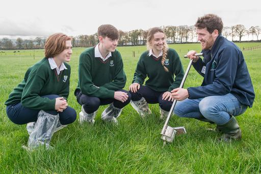 Cashel Community School students Aoife O'Connor, Calum Maher & Sarah Delaney are pictured discussing soil sampling with David Corbett in Teagasc Moorepark, Fermoy, Co Cork during Science Week. Photo O'Gorman Photography.