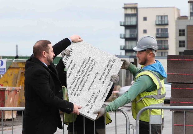 Workers quickly take the stone away. Photo: Sam Boal/RollingNews.ie