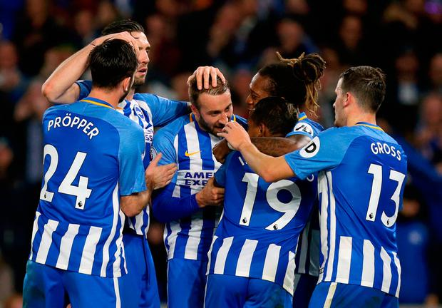 Brighton & Hove Albion's Jose Izquierdo (no 19) celebrates scoring his side's second goal of the game with team-mates during the Premier League match at the AMEX Stadium, Brighton. PRESS ASSOCIATION Photo. Picture date: Monday November 20, 2017. See PA story SOCCER Brighton. Photo credit should read: Gareth Fuller/PA Wire.