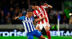 Anthony Knockaert of Brighton and Hove Albion and Ramadan Sobhi of Stoke City battle for the ball. Photo: Bryn Lennon/Getty Images