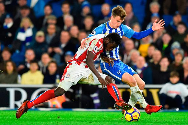 Brighton's midfielder Solly March (r) vie with Stoke City's striker Mame Biram Diouf (l). Photo: Glyn Kirk/AFP/Getty Images