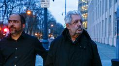 Former Venezuela soccer federation president, Rafael Esquivel (R) leaves on bail from the Brooklyn federal court next to his son Oscar in New York on March 10, 2016. Esquivel was arrested in Zurich in May as part of a U.S. investigation into alleged corruption among senior figures in world football. / AFP PHOTO / KENA BETANCUR (Photo credit should read KENA BETANCUR/AFP/Getty Images)
