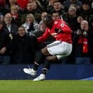 Romelu Lukaku scoring United's fourth goal against Newcastle on Saturday. Photo: Andrew Yates/Reuters