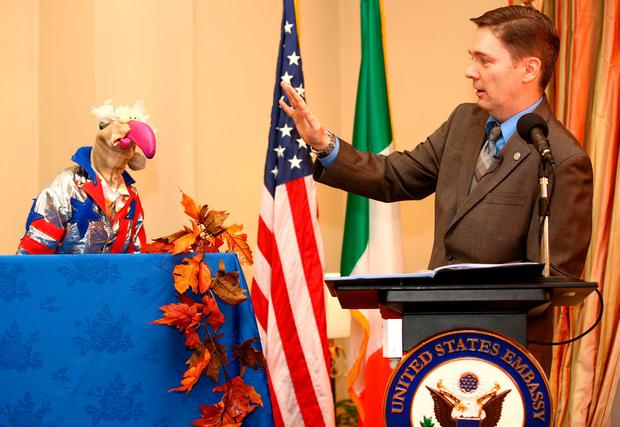 Charge d'Affaires of the US Embassy, Reece Smyth pardons Dustin the Turkey at a Thanksgiving reception at the US Ambassador's Residence in the Phoenix park. Picture: Gerry Mooney
