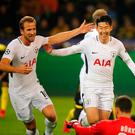 Soccer Football - Champions League - Borussia Dortmund vs Tottenham Hotspur - Signal Iduna Park, Dortmund, Germany - November 21, 2017 Tottenham's Son Heung-min celebrates scoring their second goal with Harry Kane REUTERS/Wolfgang Rattay