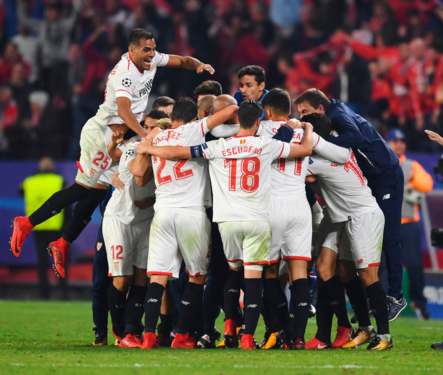 Guido Pizarro of Sevilla celebrates with teammates and staff members after scoring his side's injury-time equalising. Photo: David Ramos/Getty Images