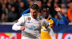 Real Madrid's Cristiano Ronaldo in action against Apoel Nicosia's Vinicius Junior. Photo: Reuters