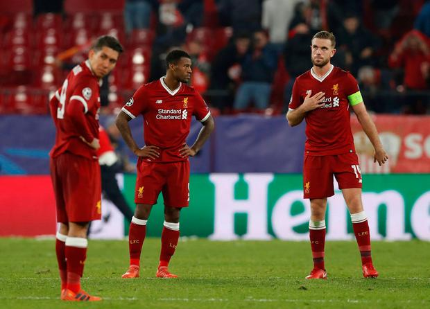 Soccer Football - Champions League - Sevilla vs Liverpool - Ramon Sanchez Pizjuan, Seville, Spain - November 21, 2017 Liverpool's Jordan Henderson, Georginio Wijnaldum and Roberto Firmino look dejected at the end of the match Action Images via Reuters/Matthew Childs TPX IMAGES OF THE DAY
