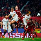 Sevilla's Wissam Ben Yedder beats Liverpool's Alberto Moreno to pull a goal back during last night's Champions League Group E clash at Estadio Ramon Sanchez Pizjuan. Photo: David Ramos/Getty Images