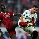 Seville's Gabriel Mercado duels for the ball with Liverpool's Sadio Mane during last night's Champions League clash. Photo: Aitor Alcalde/Getty Images