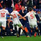 Guido Pizarro of Sevilla FC (C) celebrates after scoring the third goal of Sevilla FC with Eduardo Berizzo
