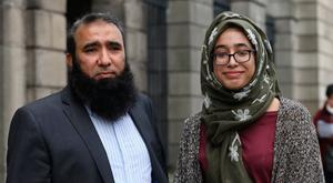 L-R Imram Jamil with his daughter, Ayesha Imram, pictured leaving the Four Courts yesterday after the High Court approved a settlement offer on behalf of Ayesha. Pic:Collins Courts