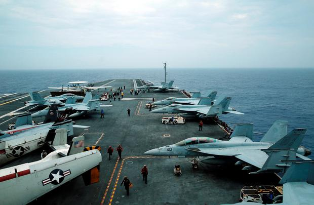 F/A-18 Hornet fighter jets and E-2D Hawkeye plane are seen on the U.S. aircraft carrier John C. Stennis during joint military exercise called Malabar, with the United States, Japan and India participating, off Japan's southernmost island of Okinawa, Japan June 15, 2016. REUTERS/Nobuhiro Kubo/File Photo