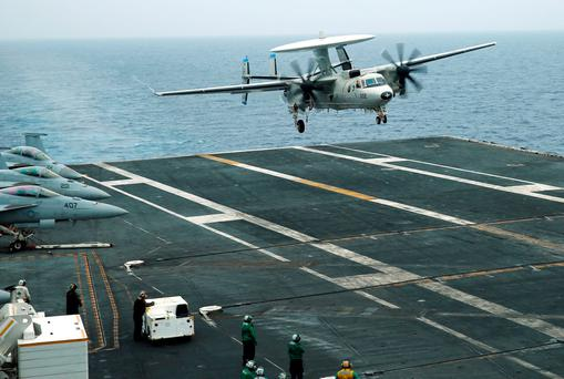An E-2D Hawkeye plane approaches to the U.S. aircraft carrier John C. Stennis during joint military exercise called Malabar, with the United States, Japan and India participating, off Japan's southernmost island of Okinawa, Japan June 15, 2016. REUTERS/Nobuhiro Kubo/File Photo