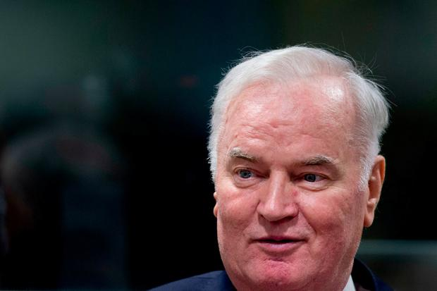 Bosnian Serb military chief Ratko Mladic enters the Yugoslav War Crimes Tribunal in The Hague, Netherlands, Wednesday, Nov. 22, 2017, to hear the verdict in his genocide trial. Mladic's trial is the last major case for the Netherlands-based tribunal for former Yugoslavia, which was set up in 1993 to prosecute those most responsible for the worst carnage in Europe since World War II. (AP Photo/Peter Dejong, Pool)