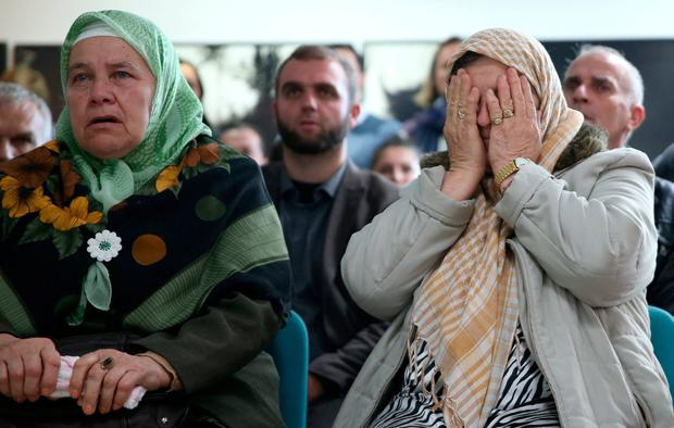 A woman reacts as she watches a television broadcast of the court proceedings of former Bosnian Serb general Ratko Mladic in the Memorial centre Potocari near Srebrenica, Bosnia and Herzegovina, November 22, 2017. REUTERS/Dado Ruvic