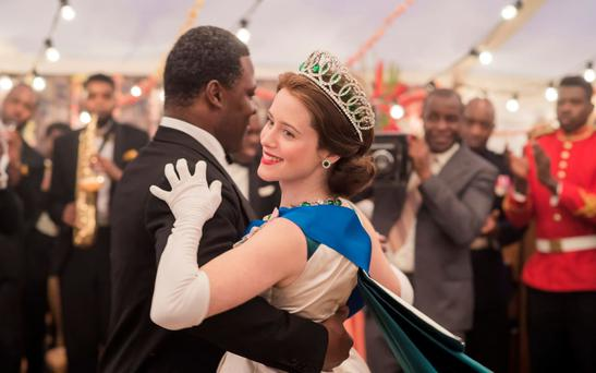 The Queen (Claire Foy) dances with Ghanaian President Kwame Nkrumah (Danny Sapani) Credit: Alex Bailey/Netflix