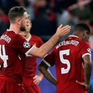 Liverpool's Georginio Wijnaldum and Jordan Henderson look dejected at the end of the match