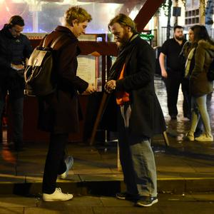 Brian Gleeson seen shooting a short movie called Dukes Govern in Temple Bar being watched by his brother Domhnall Gleeson & and comedian Sharon Horgan. In the scene Brian's female companion beats up a man in Temple Bar, Dublin, Ireland - 21.11.17. Pictures: Cathal Burke / VIPIRELAND.COM