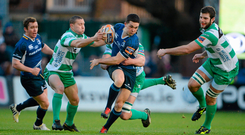 16 February 2013; Eoin O'Malley, Leinster, is tackled by Fabio Semenzato, left, and Corniel van Zyl, Benetton Treviso. Celtic League 2012/13, Round 15, Leinster v Benetton Treviso, RDS, Ballsbridge, Dublin. Picture credit: Brendan Moran / SPORTSFILE