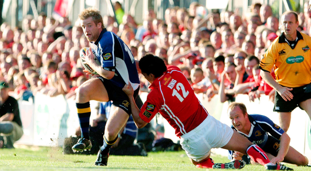 23 September 2006; Leinster wing Luke Fitzgerald escapes the clutches of Llanelli Scarlets centre Regan King. Magners Celtic League 2006 - 2007, Llanelli Scarlets v Leinster, Stradley Park, Wales. Picture credit: Tim Parfitt / SPORTSFILE