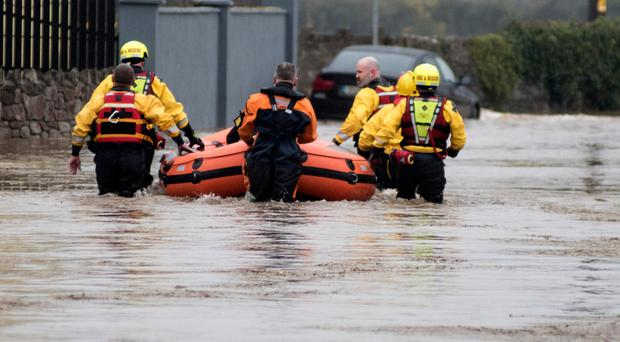 Heading back out to help remove residents from the flooding at the Manor Road, Mountmellick. Photo Kevin Byrne