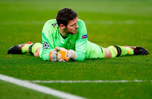 Celtic goalkeeper Craig Gordon lies dejected after PSG players scored their side's seventh goal during a Champions League Group B soccer match between Paris St. Germain and Celtic at the Parc des Princes stadium in Paris, France, Wednesday, Nov. 22, 2017. (AP Photo/Christophe Ena)