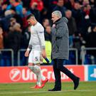 Soccer Football - Champions League - Basel vs Manchester United - St. Jakob-Park, Basel, Switzerland - November 22, 2017 Manchester United manager Jose Mourinho and Marcos Rojo look dejected after the match REUTERS/Arnd Wiegmann