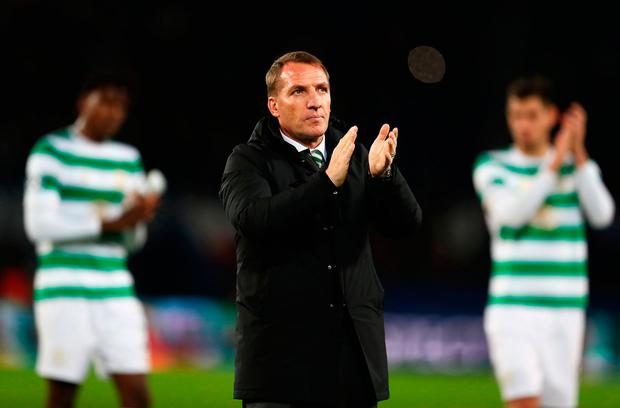 Brendan Rodgers applauds the Celtic fans after the match against PSG. Photo: Getty
