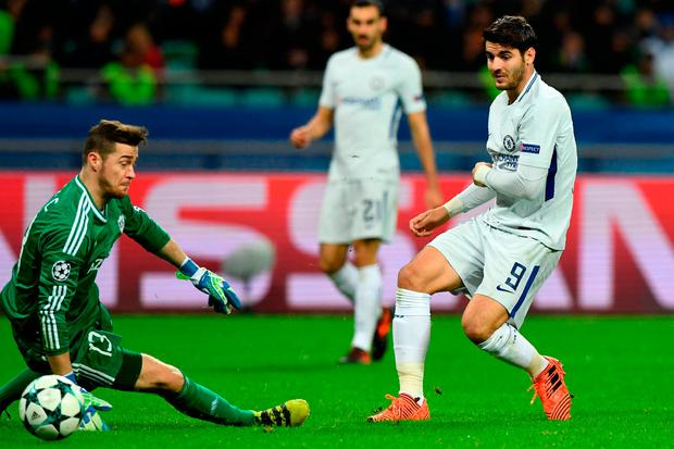 Qarabag goalkeeper Ibrahim Sehic attempts to block a shot from Chelsea forward Alvaro Morata. Photo: Getty