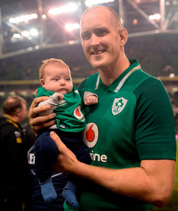 Devin Toner with his eight-week-old son Max after the victory over Fiji. Photo: Seb Daly/Sportsfile