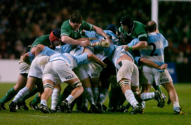 Malcolm O'Kelly and Johnny O'Connor try to stop the progress of an Argentinian maul during the feisty clash between the pair in 2004. Photo: Brendan Moran / Sportsfile