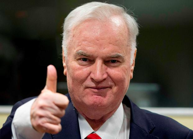 Ratko Mladic smiles as he enters court yesterday. Photo: AFP/Getty