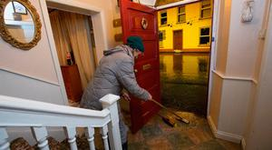 The cleanup begins during the flooding in Mountmellick, Co. Laois. Photo: Tony Gavin 22/11/2017