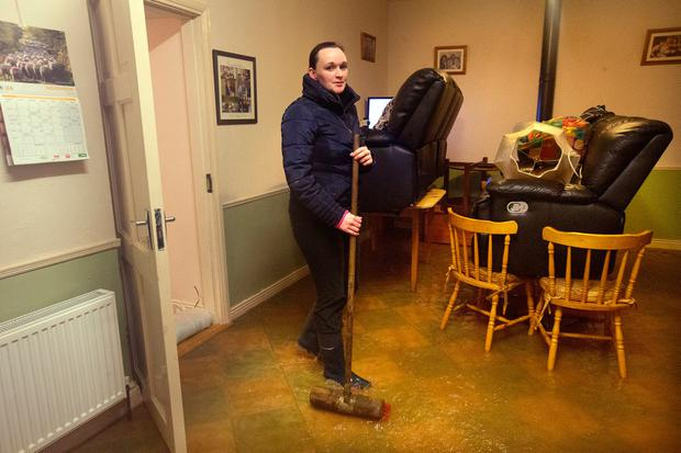 Pauline Delaney in her flooded kitchen during the flooding in Mountmellick, Co. Laois. Photo: Tony Gavin 22/11/2017