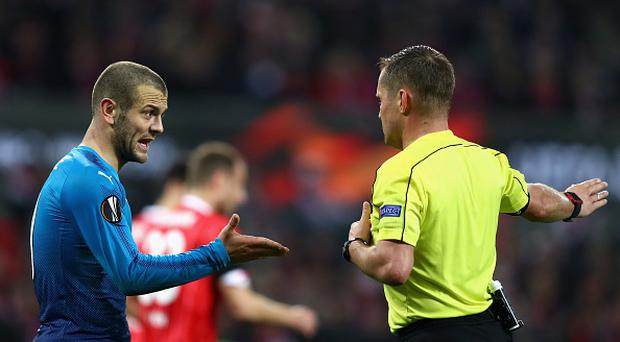 Jack Wilshere of Arsenal reacts to a decision by referee Vladislav Bezborodov during the UEFA Europa League group H match between 1. FC Koeln and Arsenal FC at RheinEnergieStadion on November 23, 2017 in Cologne, Germany. (Photo by Dean Mouhtaropoulos/Getty Images)