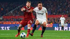 Liverpool's Alberto Moreno battles for the ball with Pablo Sarabia of Sevilla during the Champions League clash this week. Photo: Getty
