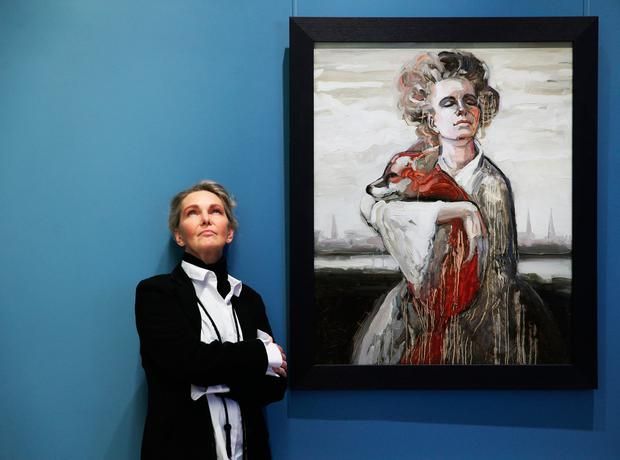 Zane Sutra stands beside her portrait Photos by Leon Farrell of Photocall Ireland