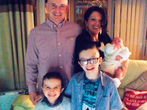 Sean McGrotty with his partner Louise, four-month-old Rionaghac-Ann, and sons Mark (11), right, and Evan (8)