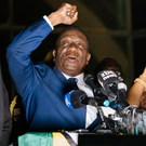 Zimbabwe's incoming president Emmerson Mnangagwa speaks to supporters, flanked by his wife Auxilia, at Zimbabwe's ruling Zanu-PF party headquarters in Harare. Photo: Getty Images