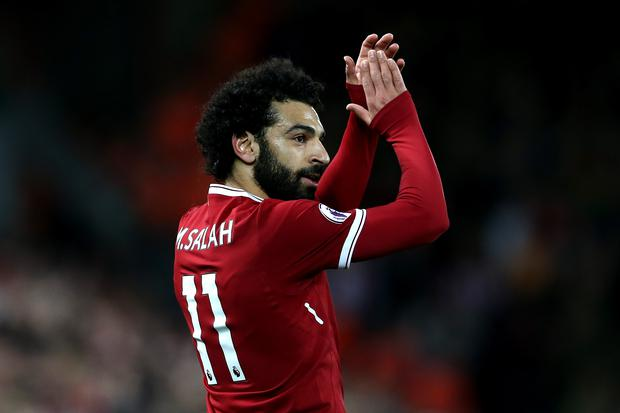 Mohamed Salah of Liverpool acknoweldges the crowd during the Premier League match between Liverpool and Southampton at Anfield on November 18, 2017 in Liverpool, England. (Photo by Jan Kruger/Getty Images)
