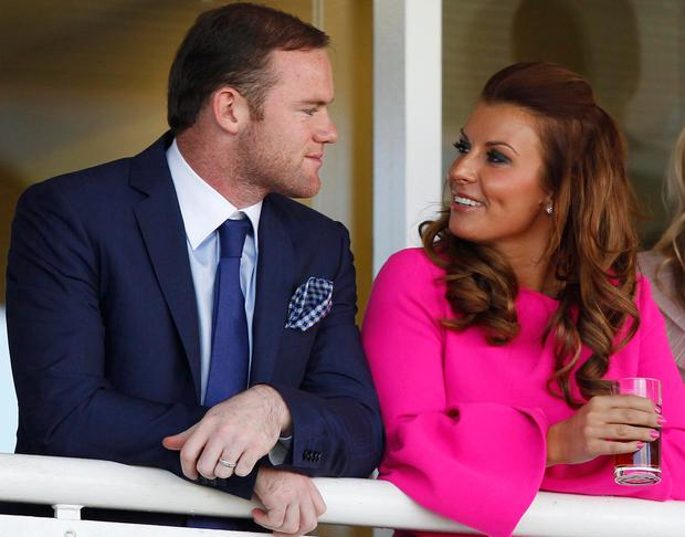 Wayne Rooney with his wife Coleen Photo: Dave Thompson/PA Wire