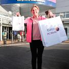 Yvonne Caffrey leaves Currys PC World in Blanchardstown during Black Friday.Photo: Leon Farrell/Photocall Ireland