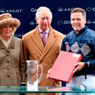 The Prince of Wales and the Duchess of Cornwall present ex-footballer Michael Owen (right) with a prize ahead of the charity race