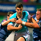 Tom Farrell of Connacht is tackled by Jarrod Evans and Corey Domachowski of Cardiff Blues