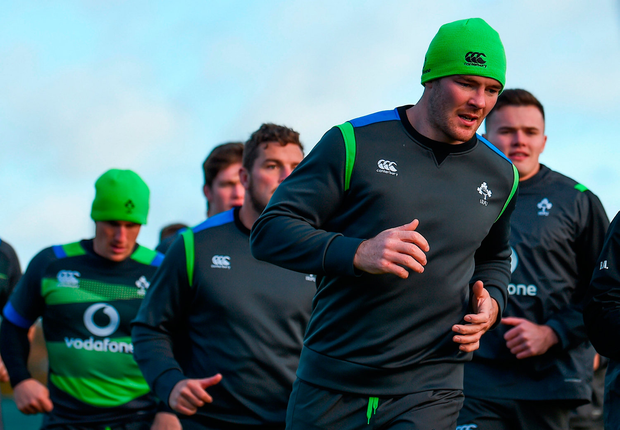 Peter O'Mahony leads the players through their paces during Ireland squad training. Photo: Sportsfile