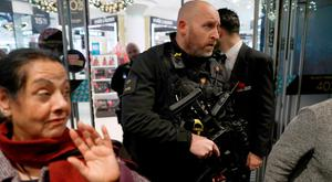 Armed police officers mix with shoppers in an Oxford Street store, in London, Britain November 24, 2017. Photo: Reuters