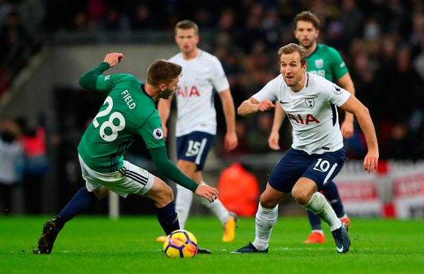 Tottenham's Harry Kane in action with West Bromwich Albion's Sam Field