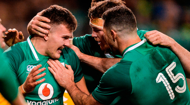 Jacob Stockdale of Ireland celebrates after scoring his side's first try with teammates Rob Kearney and Peter O'Mahony
